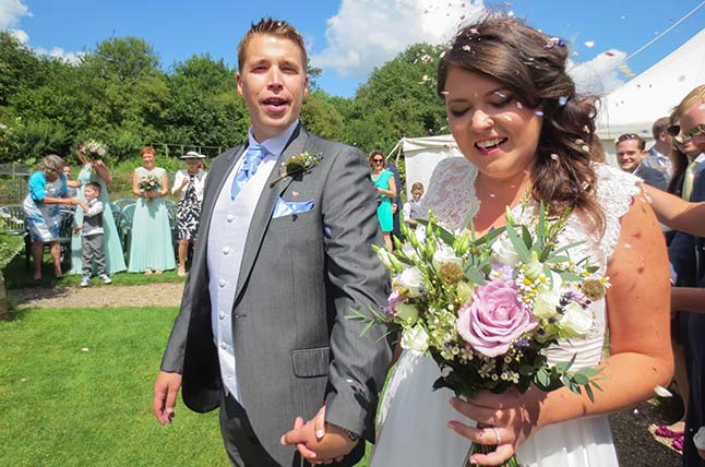 Bride and Groom with bespoke wedding bouquet in Somerset
