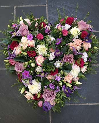 Heart shaped floral wreath ideal for funerals or bereavement. The Flower Shop, Somerset