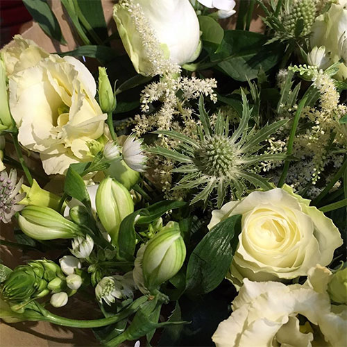 Bouquet of white flowers perfect for bereavement or funerals